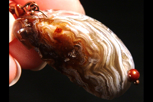 Drops of Copper Inside Agate Crystal Cave
